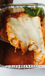 Spinach Manicotti over Vodka sauce